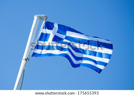 Greek Flag in the Blu Sky  - stock photo