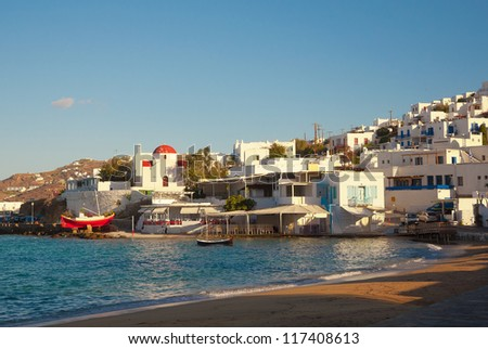 Greek island architecture - white buildings and churches, blue sea. Mykonos. - stock photo