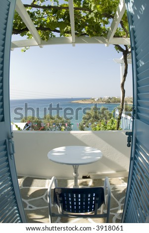 greek island view from guest house with grape arbor and classic stone patio fish eye view - stock photo