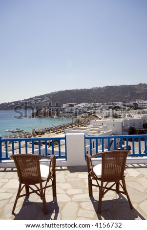 greek island view of famous platys platis gialos beach mykonos and cyclades architecture from hotel suite patio - stock photo