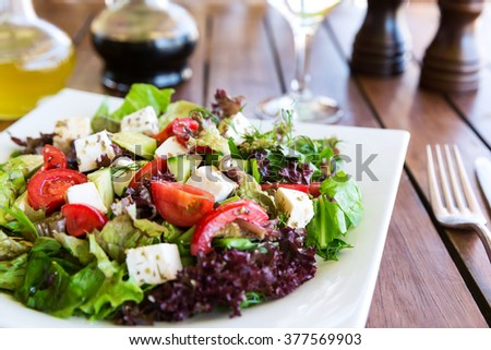 Greek Mediterranean salad with feta cheese, tomatoes and peppers. Mediterranean salad. Mediterranean cuisine. Greek cuisine.  - stock photo