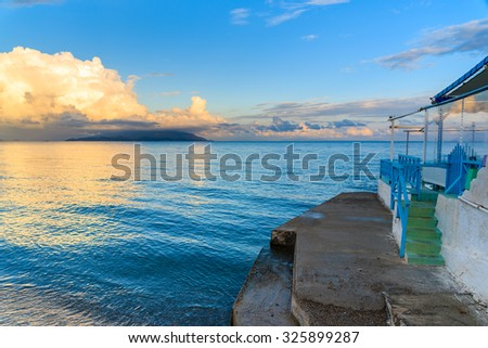 Greek restaurant on beach at sunset time, Samos island, Greece - stock photo