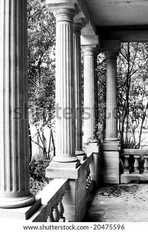 greek revival columns on abandoned mansion - stock photo