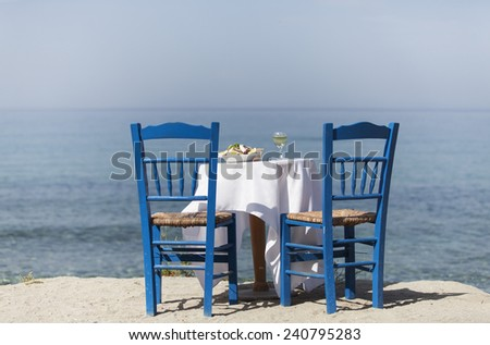 greek salad and the ocean  - stock photo