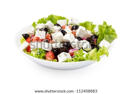 greek salad in plate isolated on white background - stock photo