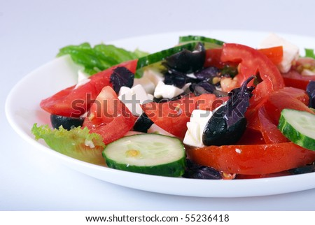 Greek salad on white plate - stock photo