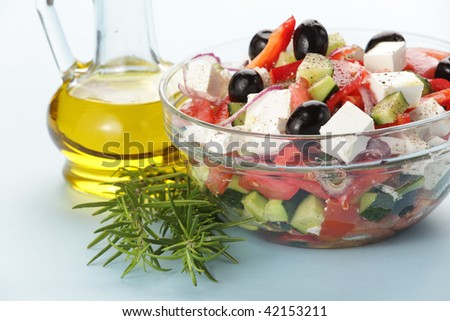 Greek salad served with olive oill - stock photo