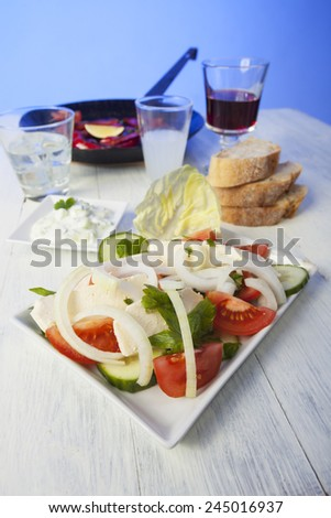 greek salad with florini peppers  - stock photo