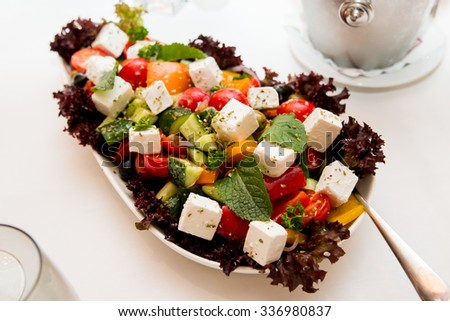 Greek salad with fresh vegetables, feta cheese and black olives hd - stock photo