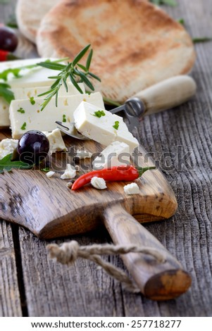 Greek snack with feta cheese, olives and pita bread - stock photo