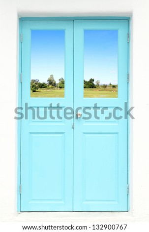 Greek style door with country field view - stock photo