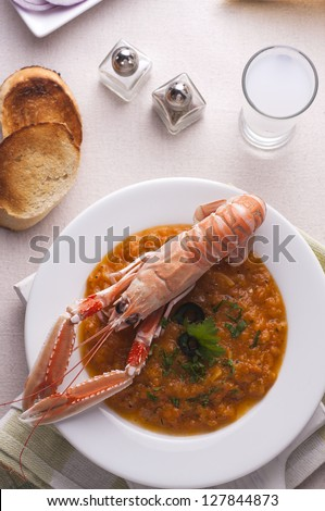 Greek style langoustine with bread and drink - stock photo
