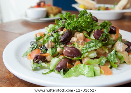 Greek style salad with a variety of vegetables. - stock photo