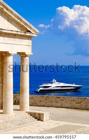 Greek symbol Pantheon near the sea with yacht. Typical Greece coastal view. - stock photo
