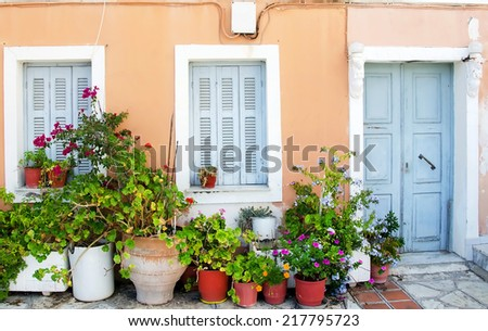 Greek traditional house,with flowers in front. - stock photo