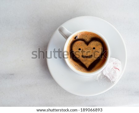 Greek Turkish coffee heart like face in the center - smile - stock photo