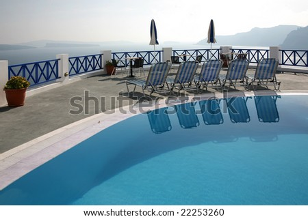 Greek vacation. Swimming pool with mediterranean sea view. - stock photo