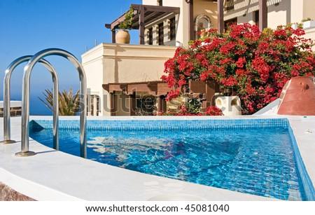 Greek villa with swimming pool, Santorini - stock photo