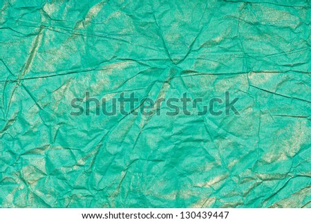 Green abstract pattern golden hue - stock photo