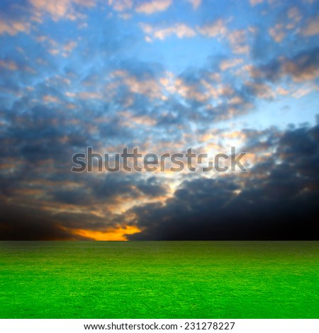 green abstract plain under solar sky - stock photo