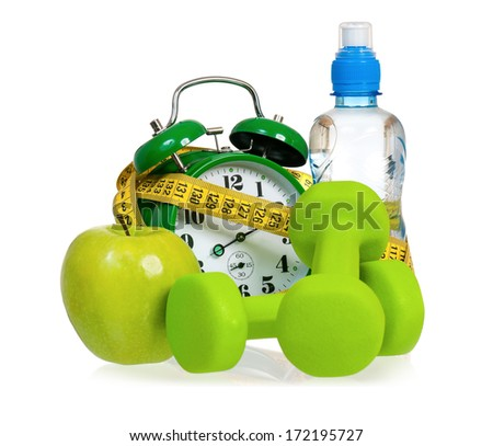 Green alarm clock, apple, bottle of water,  measuring tape and dumbbells as concept of diet - isolated on white  - stock photo