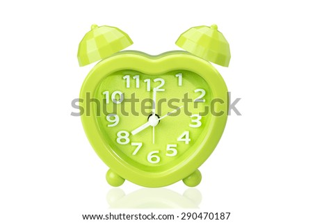 green alarm clock on white isolated background with clipping path. - stock photo