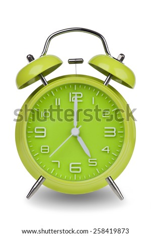 Green alarm clock with the hands at 5 am or pm isolated on a white background. One of a set of 12 images showing the top of the hour starting with 1 am / pm and going through all 12 hours - stock photo