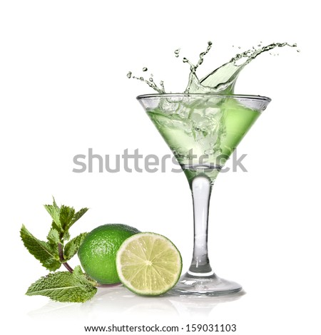 Green alcohol cocktail with splash, lime and mint isolated on white - stock photo