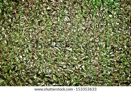 Green aluminum foil texture background. abstract wallpaper 3D - stock photo