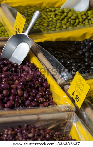 Green and black olives for sale in an open air farmer's market in Provence, France - stock photo