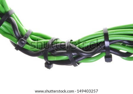 Green and black power supply wires with cable ties - stock photo