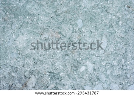 Green and blue shattered glass close up - stock photo