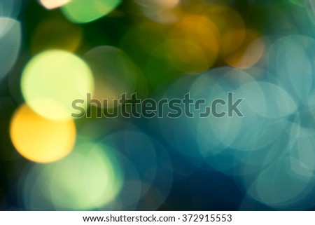 Green and gold background. Golden holiday glowing abstract glitter defocused background. Toned colorized image. - stock photo