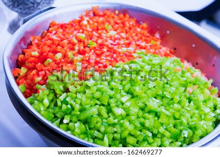 Green and red bell peppers cleaned and washed as cooking Ingredient in the restaurant, background - stock photo