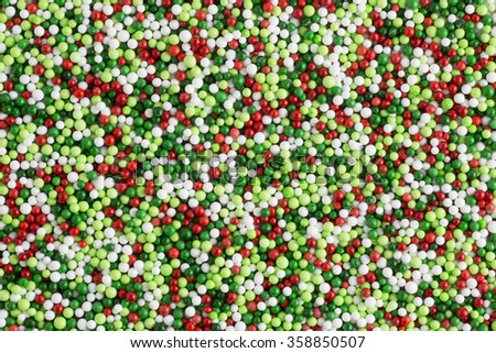 Green and red candy sprinkle decorations - stock photo