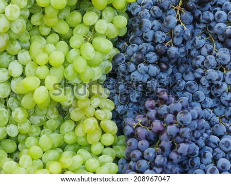 Green and red grapes on a market - stock photo