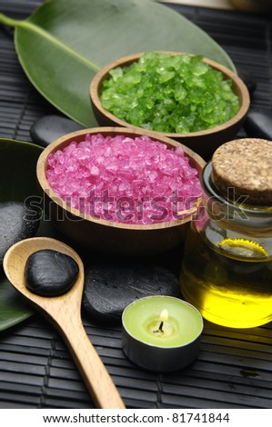 Green and red herbal salt with zen stone and leaf with massage oil set for spa - stock photo