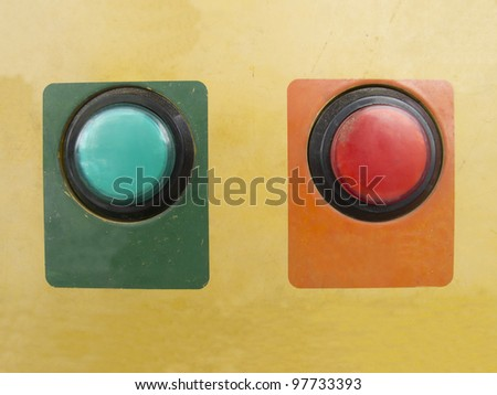 Green and red push button on gasoline vending machine - stock photo