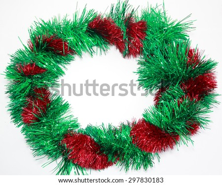 Green and red tinsel framed new year greeting card with copy space - stock photo