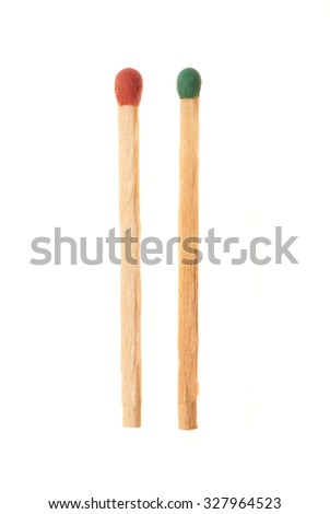 Green and red wooden matches isolated on white background - stock photo