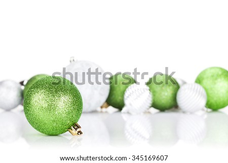 Green and silver christmas baubles. Isolated on white background - stock photo