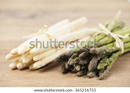 Green and white asparagus - stock photo
