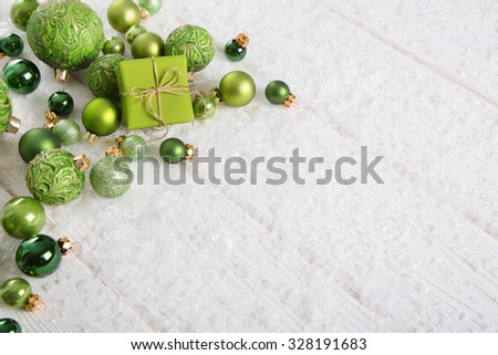 Green and white christmas background with present snow and balls for decoration items. - stock photo