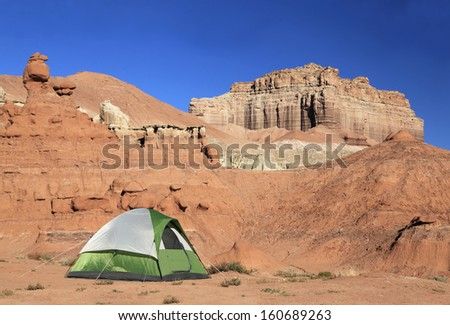 Green and white tent in the campground of Goblin Valley State Park, Utah - stock photo