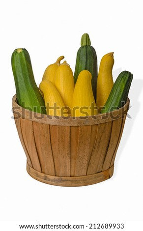 Green and Yellow Squash in Basket - stock photo