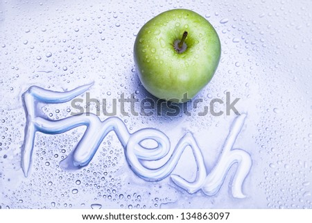 green apple and fresh caption - stock photo
