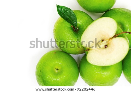 Green apple fruits and half of apple and green leaves isolated - stock photo