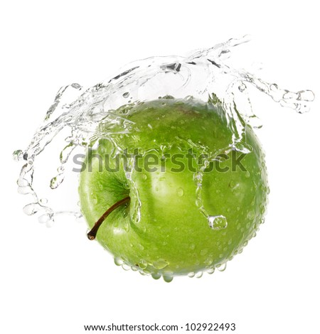 Green apple in splash of water isolated on white background - stock photo