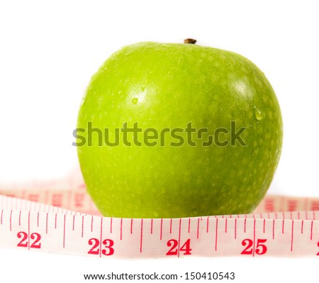 Green apple measured the meter - stock photo