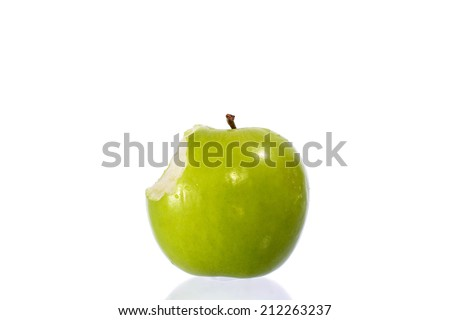 green apple  missing a bite isolated on a white background - stock photo